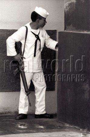 A soldier mans a port in La Libertad, El Salvador, Central America. Gary Moore photo.