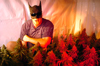 A Cannabis grower hides behind a Batman mask in front of his marijuana grow op in Vancouver, British Columbia, Canada.